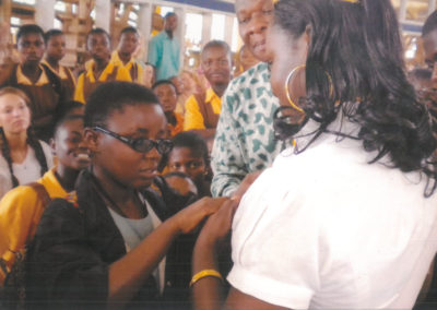 Donation of white canes to both blind, and deaf and dumb students at the Demonstration School of Deaf and Dumb.